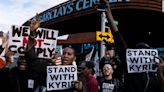 Anti-vaccine protesters support Brooklyn Nets' Kyrie Irving outside Brooklyn game