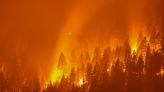 Dixie Fire, California's largest active fire burns at night in Taylorsville