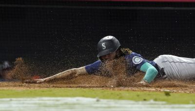 Mariners walk Ohtani in 9th, hold off Angels to keep pace
