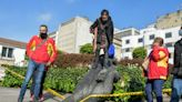 Indigenous Colombians topple conquistador statue in capital