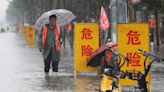 China blasts dam to divert floods that killed at least 25