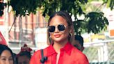 Chrissy Teigen Learns the Joy of Fly Fishing In Chunky Hiking Boots, Western Ensemble