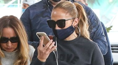 Jennifer Lopez Keeps It Casual in Baggy Jeans, White Sneakers, and a Love Sweatshirt