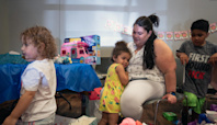 Pandemic Aid Programs Spur a Record Drop in Poverty