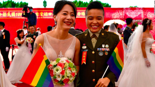 Taiwan same-sex couples join military wedding for first time