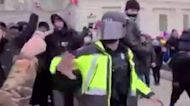 Feds release more Capitol riot video of attack on police