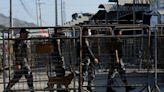 Fighting among prison gangs in Ecuador kills 22, injures 80