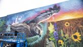 WATCH NOW: Nationally known artist's mural comes to life on West 7th Street building's wall