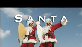 Surfing as Santa Claus in Venice Beach California