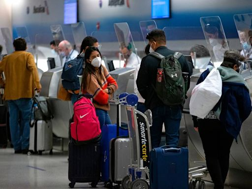 Americans warned against travel as COVID variants spread and testing rules go into effect