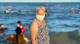 Tourism faces pushback as virus caseloads surge
