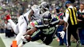 Breakdowns late send Seahawks to 33-30 overtime loss to Titans in Seattle fans' return
