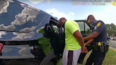 Black jogger wrestled into back of patrol car last year by San Antonio police has sued over the incident