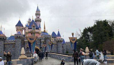 The Latest: California OKs reopening ball parks, Disneyland
