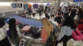 The Latest: US air travel rebounds with more vaccinations