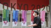 The Latest: Tokyo hits record 2,848 cases during Olympics