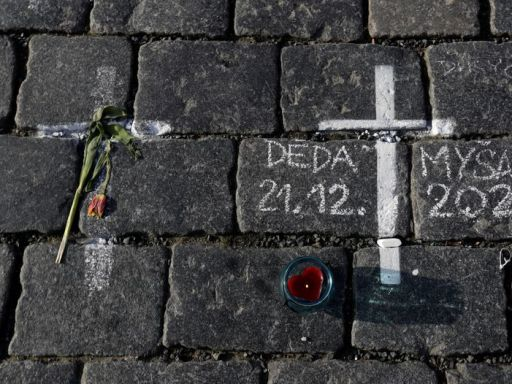 Mourners make Prague's Old Town Square into sombre memorial for coronavirus victims
