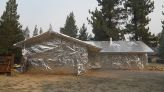 California homeowners facing wildfires use aluminum wrap to prevent damage