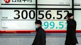 Asian stocks follow Wall Street higher after Fed pledge