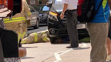 美孚新邨老婦過路捱撞 被困車底重創送院