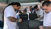 Inmates volunteer to make masks for first responders