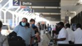 Explainer - Here's what we know about how U.S. will lift travel restrictions