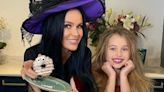 Amanda Holden looks amazing with dark hair as she dresses as witch for Halloween