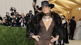 Jennifer Lopez Stuns in a Ralph Lauren Dress With a High Leg Slit and Cowgirl Hat at the Met Gala