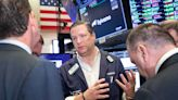 Stock futures inch lower in overnight trading after Dow retakes record high