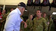 Australian prime minister tours flood zones