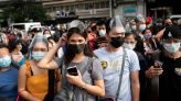 Chaos in Manila as thousands rush to get vaccine before lockdown