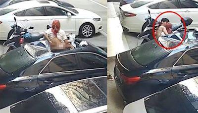 紅髮女子僅穿內褲從天降壓爛車 下秒半裸男衝來「獻吻」