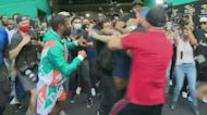 Floyd Mayweather & Jake Paul Get Into Tussle Over Hat At Exhibition Fight Presser In Miami