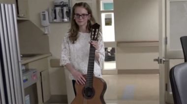Girl returns to same NICU she spent time in to play music to premature babies