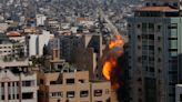 Israel airstrike in Gaza levels building housing AP, Al-Jazeera, other media