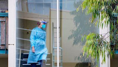 Australia hits vaccine milestone as Melbourne cases hover near record levels