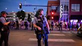 Police with assault rifles and silencers clear out memorial to slain Black man in Minneapolis