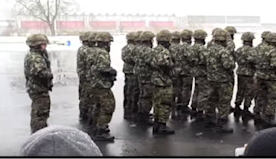 Swiss army soldiers get into formation - then bring the house down with rousing 'We Will Rock You'
