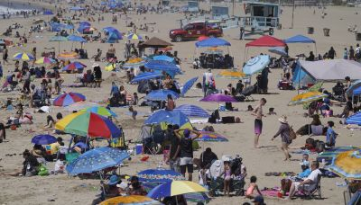 Sun's out, surf's up and California's reopening more widely