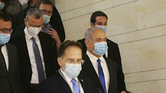 Israelis end stalemate, swear in government