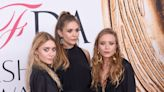 Elizabeth Olsen wears a dress designed by sisters Mary-Kate, Ashley Olsen to the 2021 Emmys