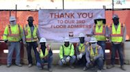 Construction workers and assisted-living residents form unlikely bond