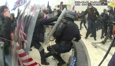 Newly released Capitol riot videos show police battling the mob