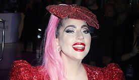 Lady Gaga Looks Like A Sexy Christmas Present In Sparkly Red Mini Dress & Matching Bow