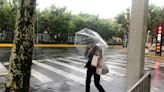 Typhoon blows across Shanghai, fills city roads with water