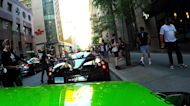 Crowd goes crazy as exotic car club arrives in the streets of Montreal