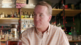 Peyton Manning is making cold calls to Indy liquor stores to put his bourbon on shelves
