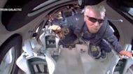 Richard Branson soars into space aboard Virgin Galactic rocket plane