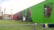 Artists update beloved mural in west Baltimore after it deteriorates