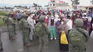 Ecuador: At least 18 inmates die in two prison riots